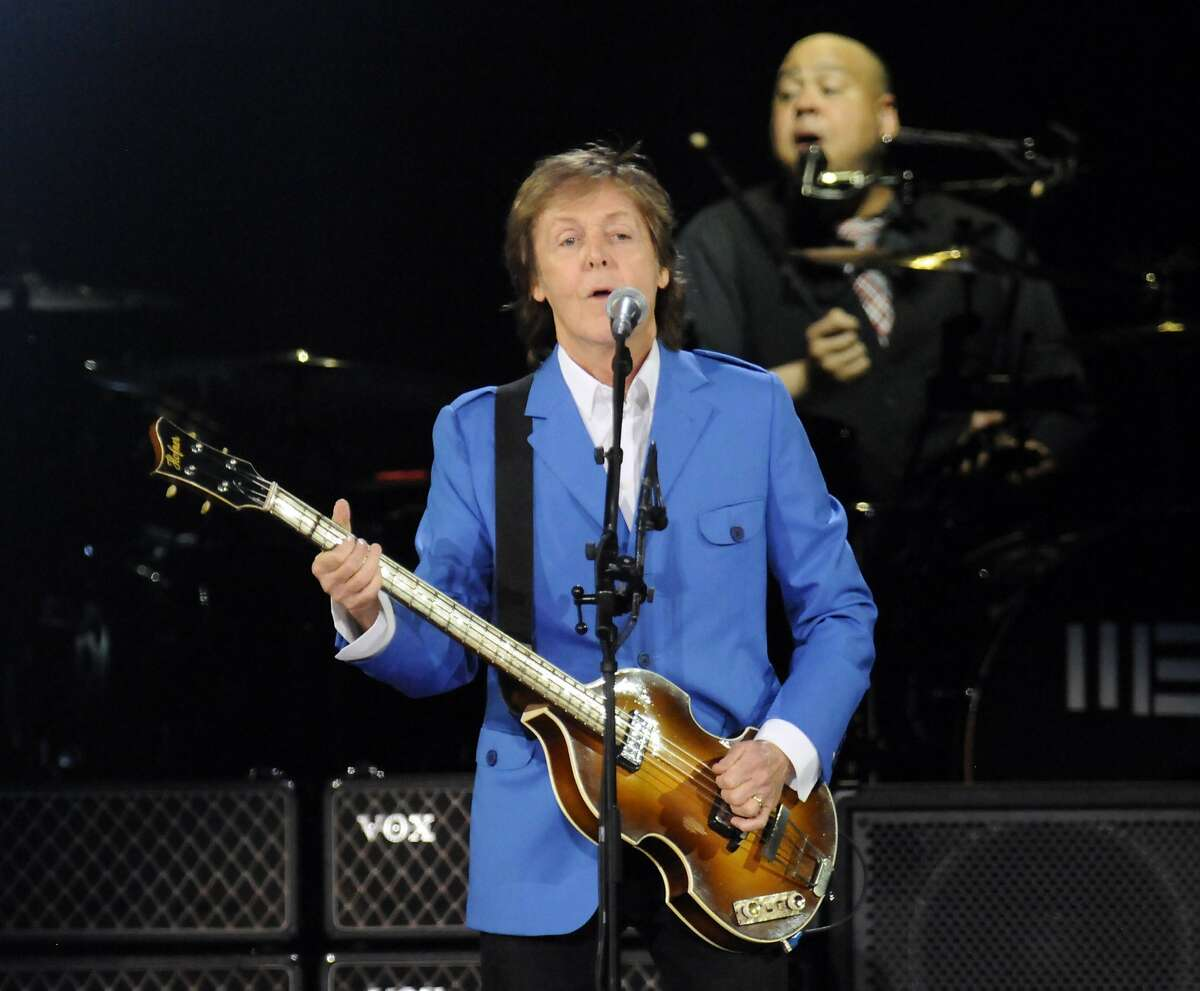 """Sir Paul McCartney performs with his band during the """"Out There"""" Tour at the Times Union Center on Saturday, July 5, 2014, in Albany, N.Y. (Photo by Hans Pennink/Invision/AP)"""