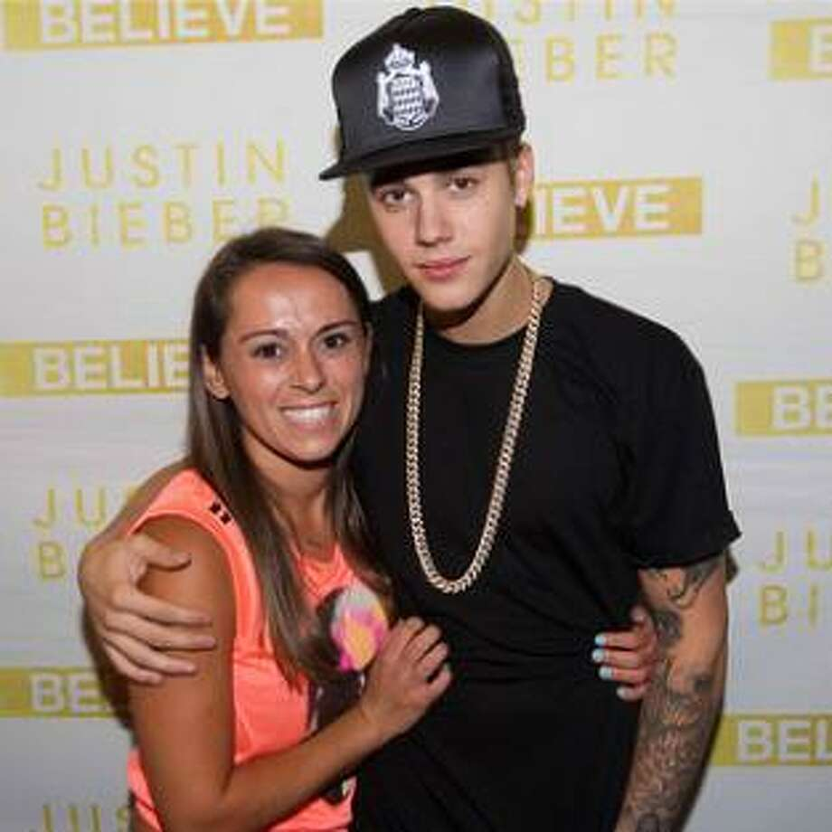Photo of pop star Justin Bieber and Dutchess County resident Alicia M. Tamboia, who was killed in a crash between exits 24 and 25 of the New York state Thruway Friday July 4, 2014. Thousands of other Bieber fans paid tribute to Tamboia on Twitter. (Facebook)