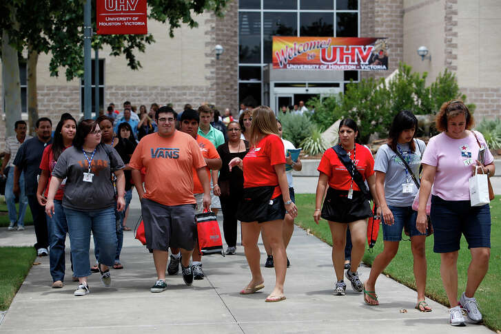 Sara Cartee, left, and her fiancé Alfonso Ramos, center, both from Victoria, Texas walk through campus during freshmen orientation at University of Houston-Victoria campus on June 23, 2010. Until now, UHV has offered only upper-division and graduate classes. This is seen as a key step in its goal of becoming a destination liberal arts university. But some Victoria leaders are unhappy with the UH system, because it wants regents to move the campus to the edge of town, where land is available for expansion and other development. Photo by Ivan Pierre Aguirre/San Antonio Express-News