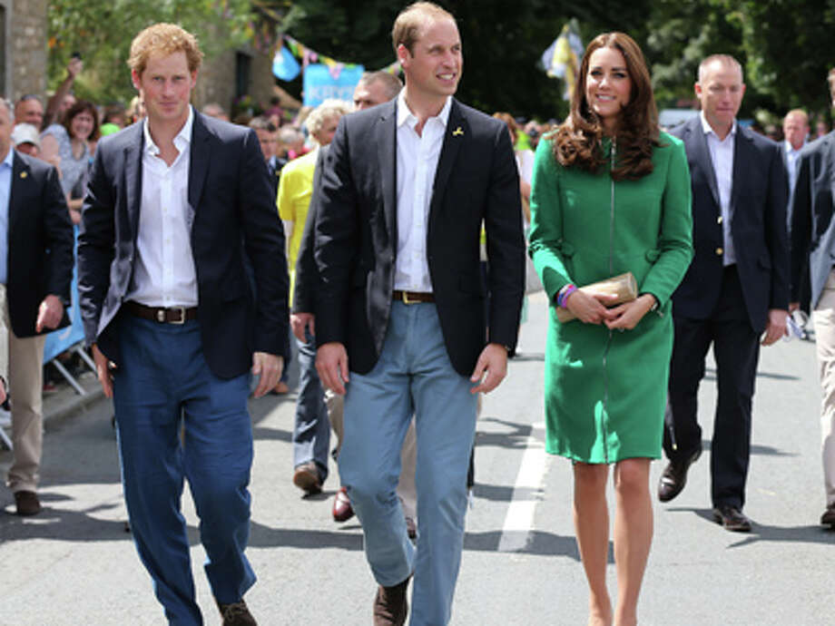 Prince William, centre, Kate Duchess of Cambridge and Prince Harry walk along the street to celebrate the start of the Tour de France in Yorkshire at West Tanfield, England, Saturday, July 5, 2014. The 198 competitors in the 101st Tour de France have started their grueling three-week ride through four countries before ending the world's greatest cycling race in Paris on July 27. Photo: Scott Heppell, AP / AP