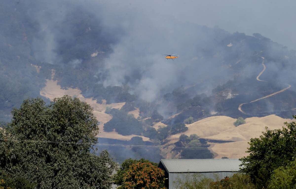 A helicopter flew over the northern flank of the fire. Firefighters made significant gains against the Monticello fire near Lake Berryessa Sunday July 6, 2014 and residents began returning to their homes.