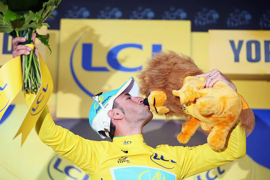 Vincenzo Nibali of Italy kisses a stuffed lion after capturing Stage 2. The mascot of a sponsor has long been given daily to the stage winner. Photo: Bryn Lennon, Getty Images
