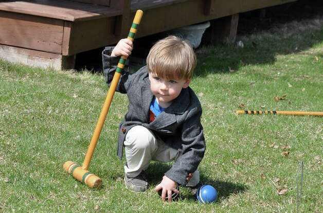 Although it appears that two-year-old Payton is carefully planning the angle of his shot, in reality all he wants to do is hit the ball ? any ball! He is the son of Becca Golden and Chris Rahm of Latham. (Barb Roosevelt, Clifton Park)