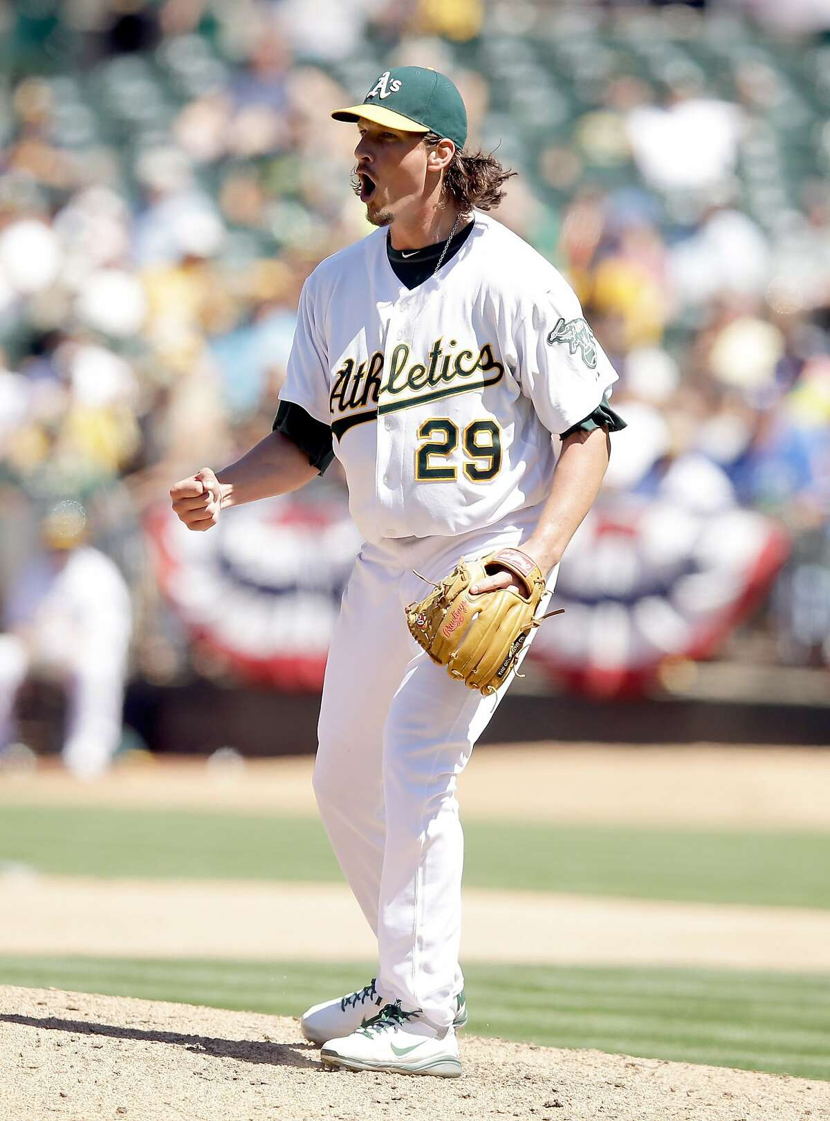 OAKLAND, CA - JULY 06: Jeff Samardzija #29 of the Oakland Athletics reacts after he struck out three batters in a row in the seventh inning of their game against the Toronto Blue Jays at O.co Coliseum on July 6, 2014 in Oakland, California. (Photo by Ezra Shaw/Getty Images)