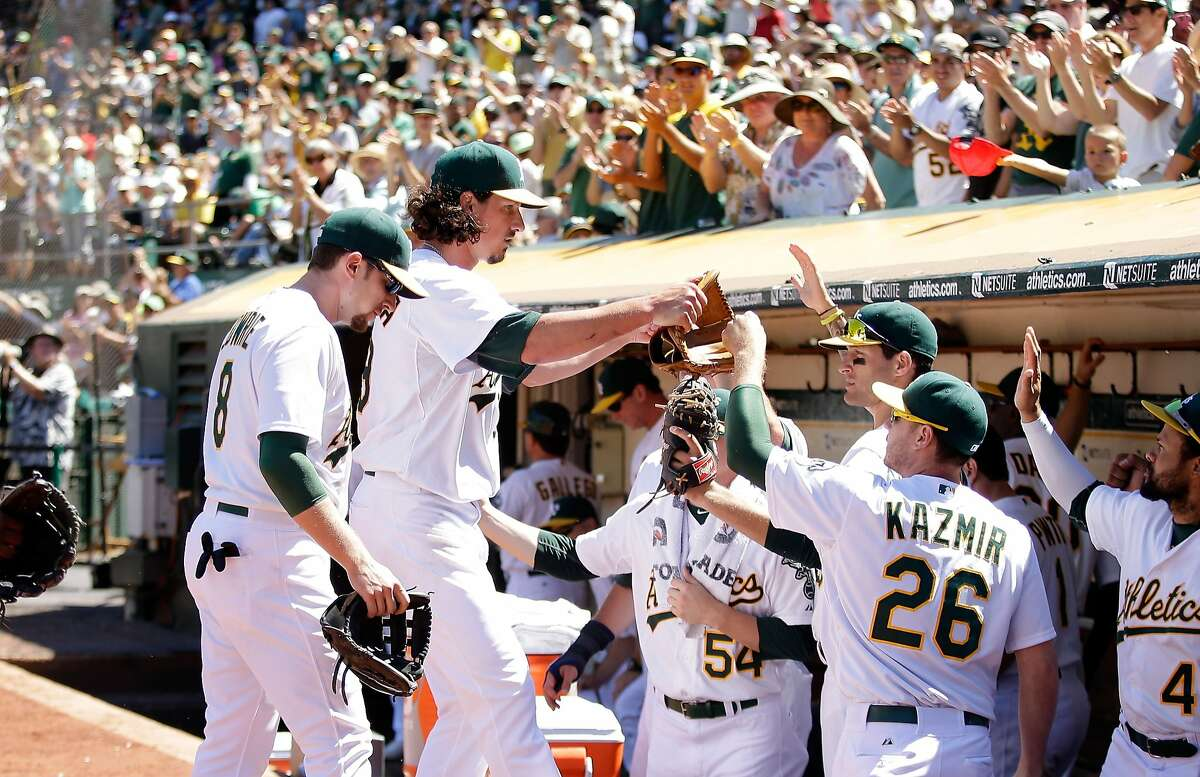 OAKLAND, CA - JULY 06: Jeff Samardzija #29 of the Oakland Athletics is congratulated by teammates after he struck out three batters in a row in the seventh inning of their game against the Toronto Blue Jays at O.co Coliseum on July 6, 2014 in Oakland, California. (Photo by Ezra Shaw/Getty Images)