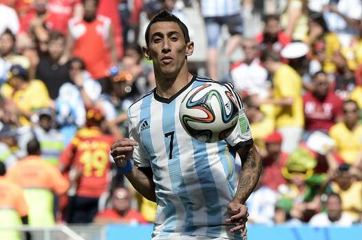 Argentina's midfielder Angel Di Maria eyes the ball during a quarter-final football match between Argentina and Belgium at the Mane Garrincha National Stadium in Brasilia during the 2014 FIFA World Cup on July 5, 2014. AFP PHOTO / JUAN MABROMATAJUAN MABROMATA/AFP/Getty Images Photo: JUAN MABROMATA, AFP/Getty Images / AFP