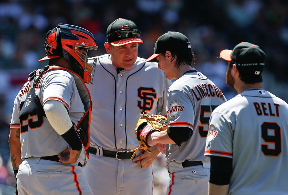 Coach Dave Righetti (second from left) doesn't see himself as a miracle worker but does have ideas about protecting arms. Photo: Lenny Ignelzi / Associated Press / AP