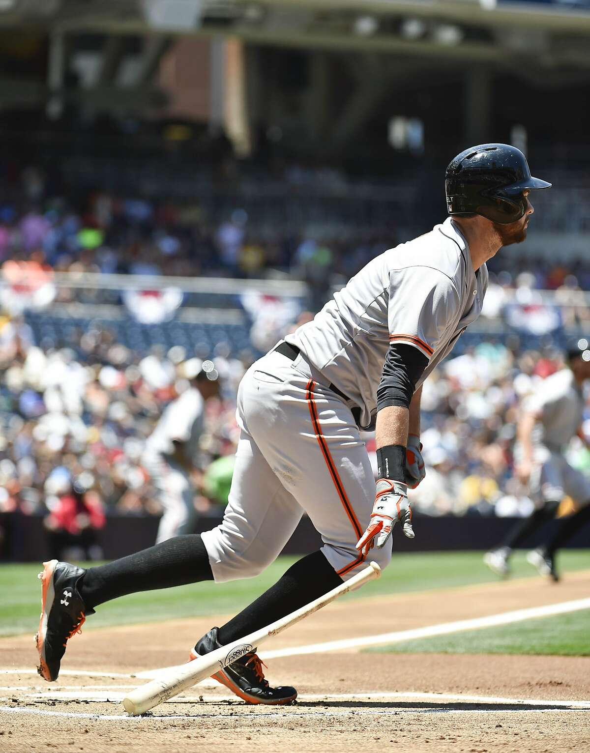 SAN DIEGO, CA - JULY 6: Brandon Belt #9 of the San Francisco Giants hits an RBI single during the first inning of a baseball game against the San Diego Padres at Petco Park July 6, 2014 in San Diego, California. (Photo by Denis Poroy/Getty Images)