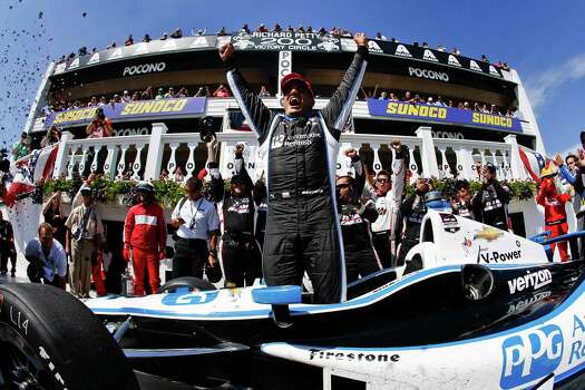 LONG POND, PA - JULY 6 :  Juan Pablo Montoya of Colombia, driver of the #2 PPG Team Penske Chevrolet, celebrates his victory in the Pocono INDYCAR 500 at Pocono Raceway on July 6, 2014 in Long Pond, Pennsylvania. Photo: Jeff Zelevansky, Getty Images / 2014 Getty Images