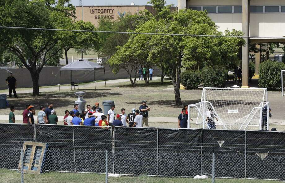 Young immigrants stay at a housing area at Joint Base San Antonio-Lackland, site of an emergency shelter for the surge of immigrants from Central America. Photo: San Antonio Express-News File Photo / © 2014 San Antonio Express-News