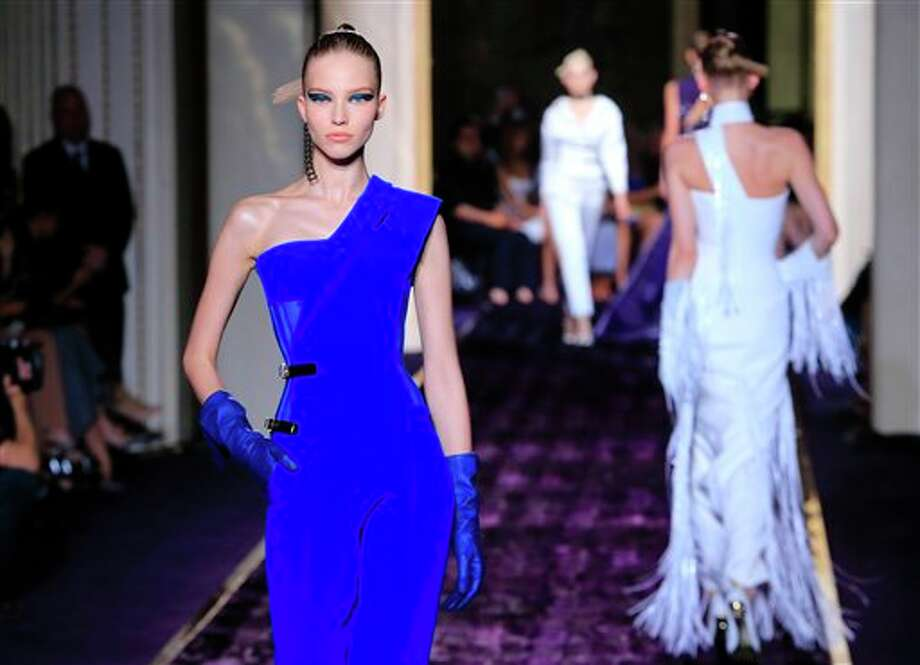 Models present creations by Italian fashion designer Donatella Versace, as part of the Atelier Versace Fall Winter 2014-15 Haute Couture fashion collection, Sunday, July 6, 2014, in Paris. (AP Photo/Jacques Brinon) Photo: Jacques Brinon, Associated Press / AP