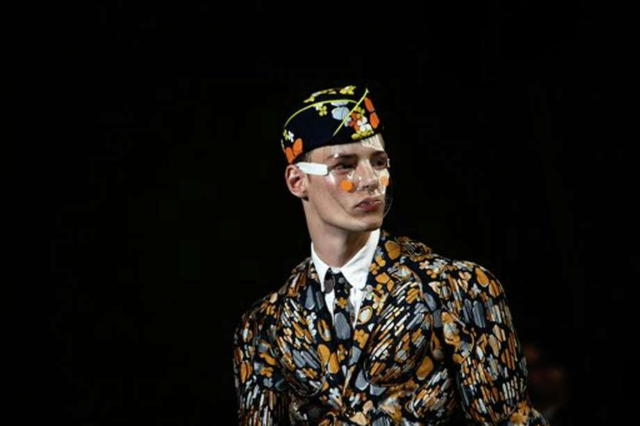 Models wear creations by American designer Thom Browne, as part of his men's Spring-Summer 2015 fashion collection, presented in Paris, Sunday, June 29, 2014. (AP Photo/Thibault Camus) Photo: Thibault Camus, Associated Press / AP