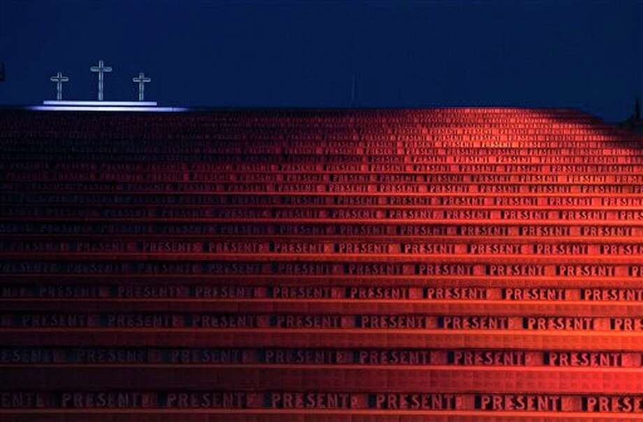 A night view of the Redipuglia monument to WWI dead, northeastern Italy, during Verdi's Requiem Mass conducted by Italian Maestro Riccardo Muti (not shown) to mark the 100th anniversary of World War I's outbreak in Europe and honor its millions of war dead, Italy, Sunday, July 6, 2014. (AP Photo/Paolo Giovannini) Photo: Paolo Giovannini, Associated Press / AP