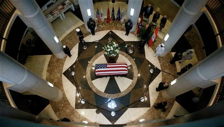 The body of former Tennessee Senator Howard Baker lies in state at the The Howard H. Baker, Jr. Center for Public Policy Monday, June 30, 2014, in Knoxville, Tenn. He died June 26 at age 88. His funeral was scheduled in Huntsville on Tuesday. (AP Photo/Wade Payne) Photo: Wade Payne, Associated Press / FR23601 AP