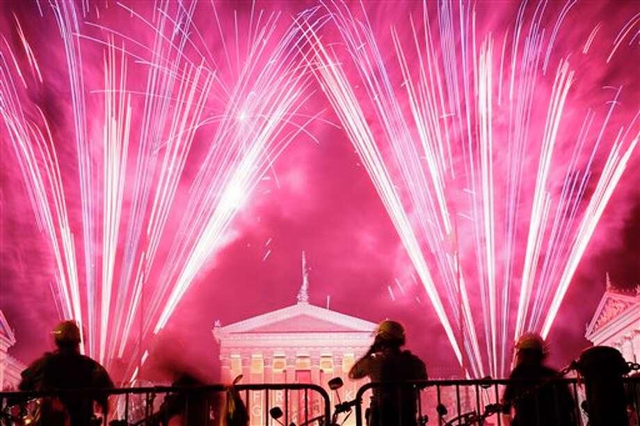Fireworks explode over the Philadelphia Museum of Art during an Independence Day celebration, Friday, July 4, 2014, in Philadelphia. (AP Photo/Matt Rourke) Photo: Matt Rourke, Associated Press / AP