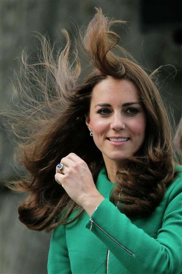 The wind plays with the hair of Kate, Duchess of Cambridge, as she watches the final of the first stage of the Tour de France cycling race over 190.5 kilometers (118.4 miles) with start in Leeds and finish in Harrogate, England, Saturday, July 5, 2014. (AP Photo/Christophe Ena) Photo: Christophe Ena, Associated Press / AP
