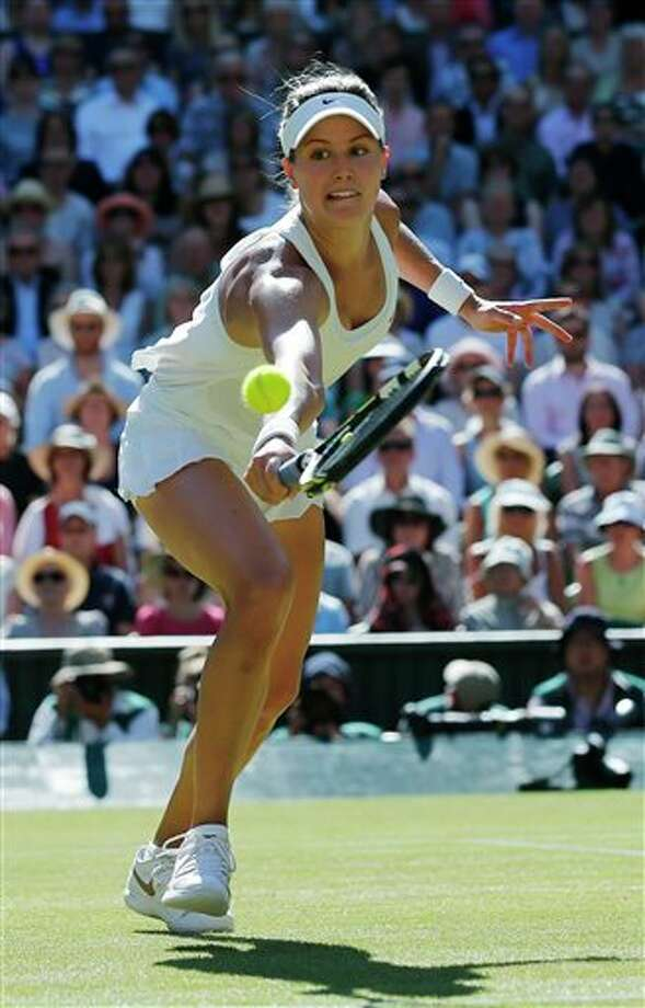 Eugenie Bouchard of Canada runs to play a return to Simona Halep of Romania during their women�s singles semifinal match at the All England Lawn Tennis Championships in Wimbledon, London, Thursday, July 3, 2014. (AP Photo/Ben Curtis) Photo: Ben Curtis, Associated Press / AP