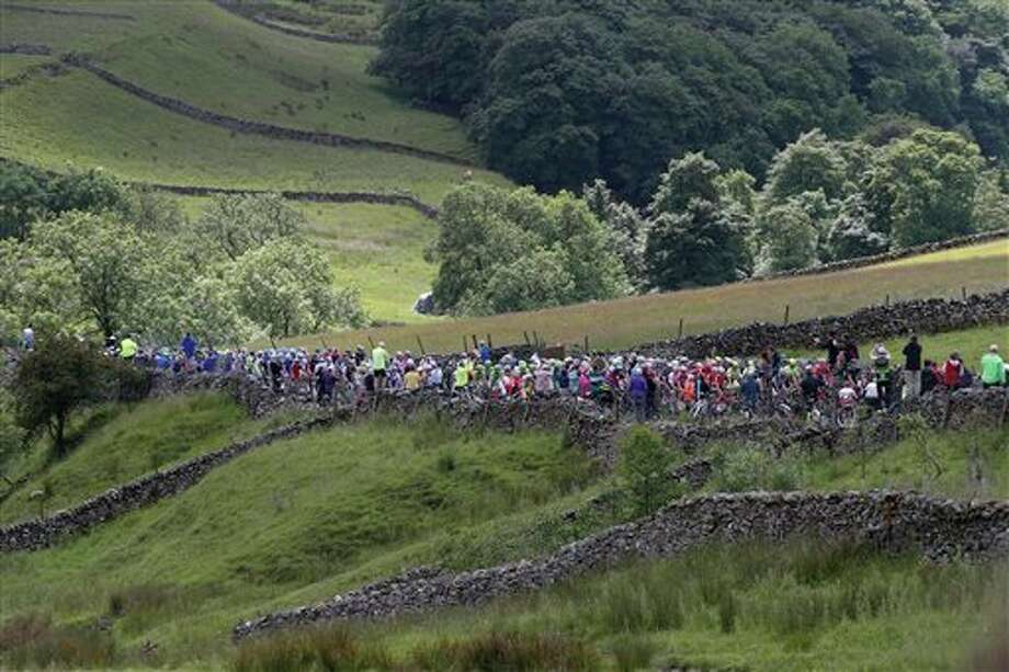 The pack climbs the rolling hills of Yorkshire during the first stage of the Tour de France cycling race over 190.5 kilometers (118.4 miles) with start in Leeds and finish in Harrogate, England, Saturday, July 5, 2014. (AP Photo/Christophe Ena) Photo: Christophe Ena, Associated Press / AP