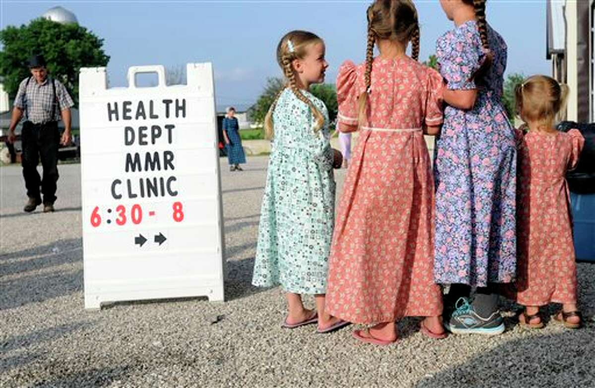 In this June 25, 2014 photo, young Mennonite girls gather at the health and safety clinic, which included a Measles, Mumps, & Rubella vaccinations in Shiloh, Ohio. Health officials said Ohio�s current outbreak of measles consists of more than 360 cases and is the biggest in the U.S. since 1994. The outbreak started after Amish travelers to the Philippines contracted measles this year and returned home to rural Knox County Ohio. (AP Photo/Tom E. Puskar)