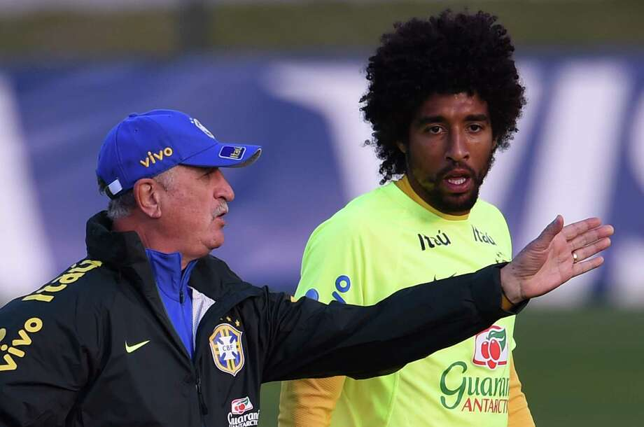 Brazil coach Luiz Felipe Scolari, left, directing defender Dante during Sunday's training session, has a difficult decision to make choosing a replacement for Neymar for Tuesday's semifinal against Germany. Photo: VANDERLEI ALMEIDA, Staff / AFP