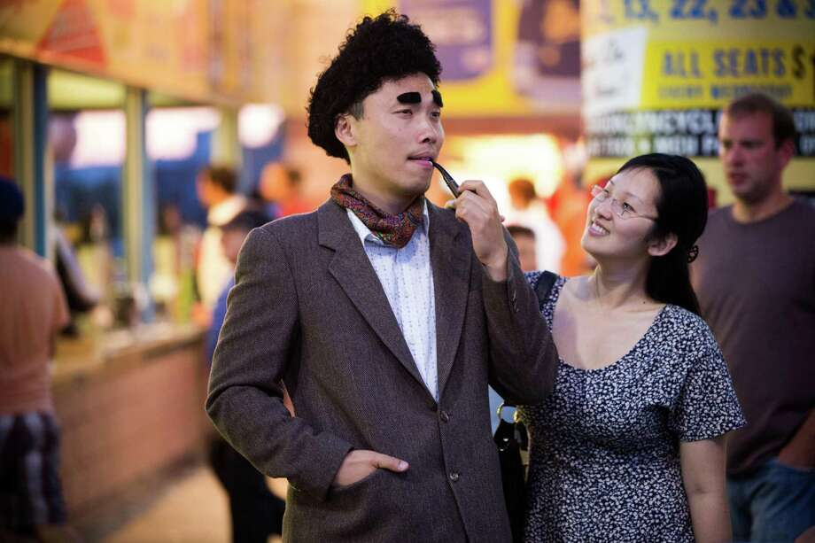 Jimmy Cheung and Jenny Cheng, dressed as characters Kramer and Elaine, helped celebrate the 25 years since the debut 'Seinfeld' on Saturday at MCU Park. Photo: PIOTR REDLINSKI, STR / NYTNS