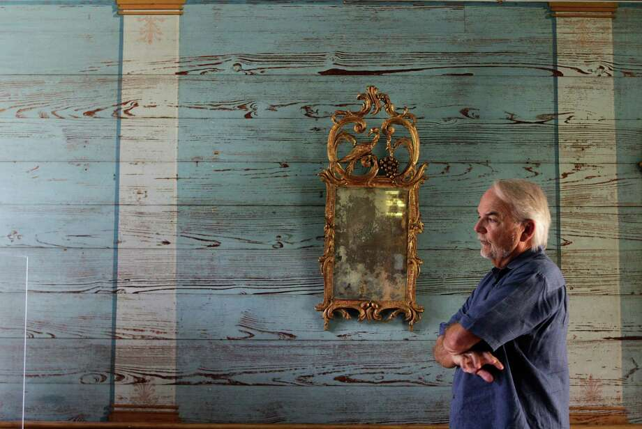 Don Carleton, executive director of the Archives of American History, stands by a painting meant to give the illusion of columns in the McGregor House's entryway at the Winedale Historical Complex. Photo: Mayra Beltran / © 2014 Houston Chronicle