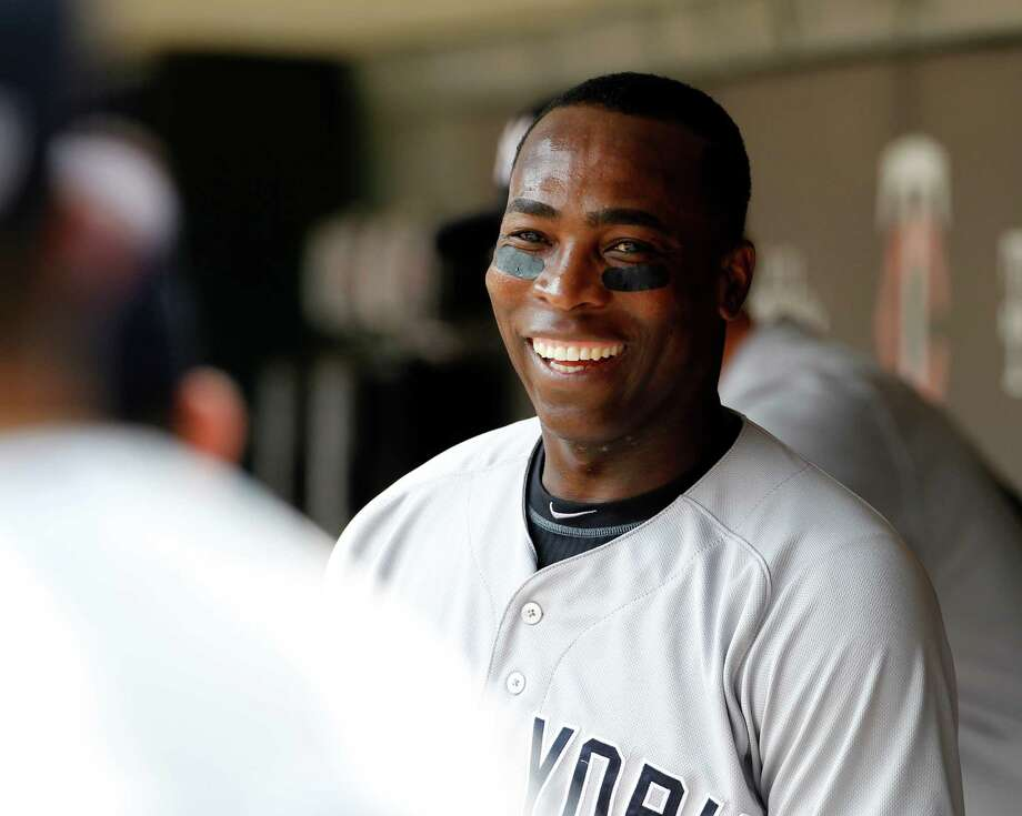 New York Yankees left fielder Alfonso Soriano smiles at a teammate in the dugout before a baseball game against the Minnesota Twins in Minneapolis, Saturday, July 5, 2014. (AP Photo/Ann Heisenfelt) Photo: Ann Heisenfelt, FRE / FR13069 AP