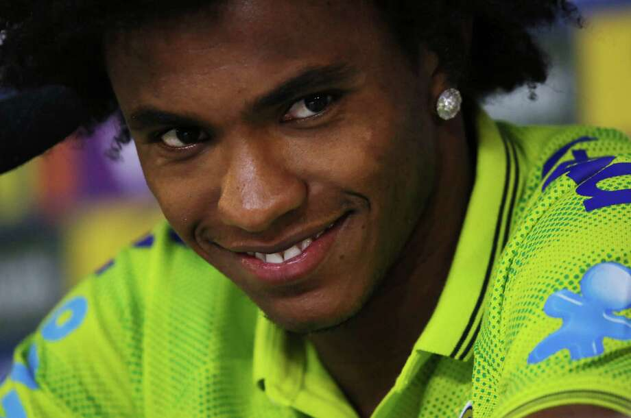 Brazil's Willian smiles as he listens to a question during a press conference at the Granja Comary training center in Teresopolis, Brazil, Sunday, July 6, 2014.  Brazil will face Germany on Tuesday in their World Cup semifinals' match, without superstar soccer player Neymar. (AP Photo/Leo Correa) ORG XMIT: XLC105 Photo: Leo Correa / AP