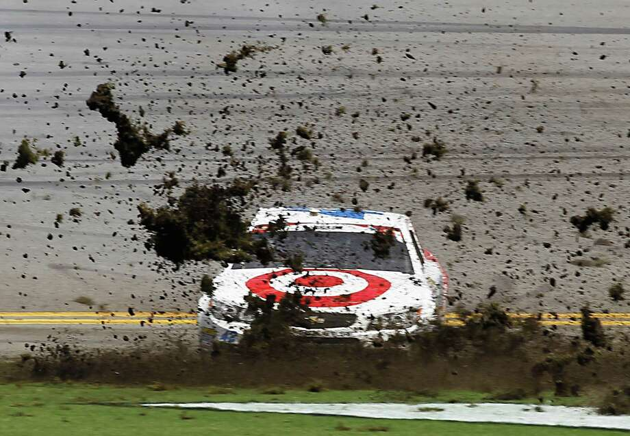 Kyle Larson creates a muddy mess during one of Sunday's crashes at rain-soaked Daytona, with one involving 26 cars and another 16. Photo: Terry Renna, FRE / FR60642 AP