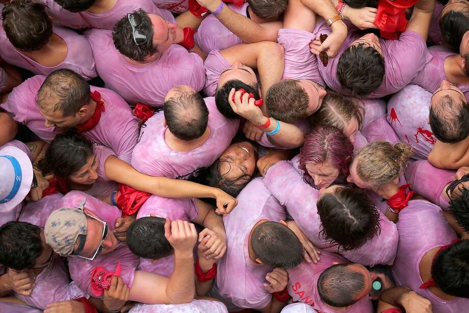Too many revelers, too little space:A rowdy, wine-soaked crowd crushes a woman during the firing of the Chupinazo rocket, which opens the Festival of the San Fermin Running of the Bulls in Pamplona, Spain. Photo: Christopher Furlong, Getty Images