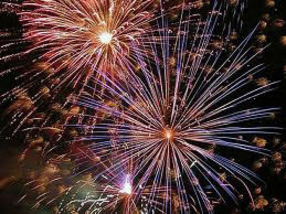The town's annual fireworks show, rescheduled from last week because of rainy weather, is set for tonight at dusk -- about 9 p.m. -- at Compo Beach. The event is sponsored by the Westport Police Athletic League and the town's Parks and Recreation Department. Photo: File Photo / Westport News