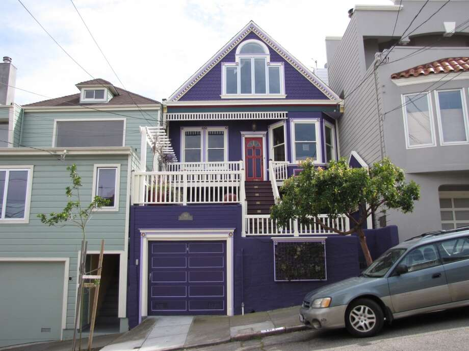 More conventional -- relatively, by the standards of 21st Century San Francisco -- is this vivid purple house on the 100 block of Randall Street in Glen Park. Photo: John King, The Chronicle