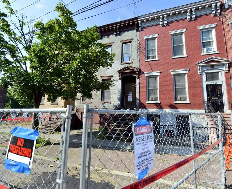 Asbestos warnings keep the unauthorized from getting near partially collapsed 162 Clinton Ave. in Albany. (Skip Dickstein/Times Union)