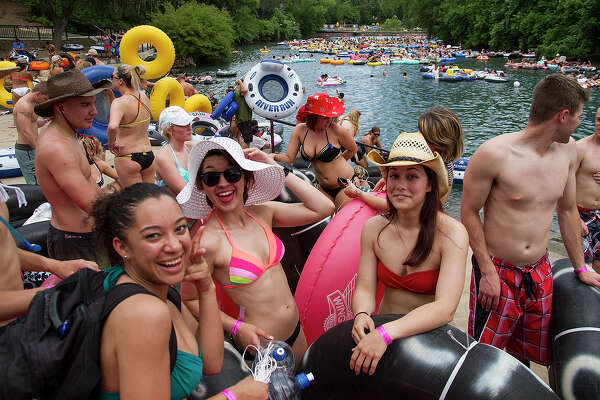 (Left to right) Tysha Lopez, Amber Perez and Kathryn Horvatitz ready for tubing on the Comal River in Prince Solms Park, Sunday, May 25, 2014 in celebration of Memorial Day. Lopez and Perez are in the Navy and Horvatitz is in the Air Force.
