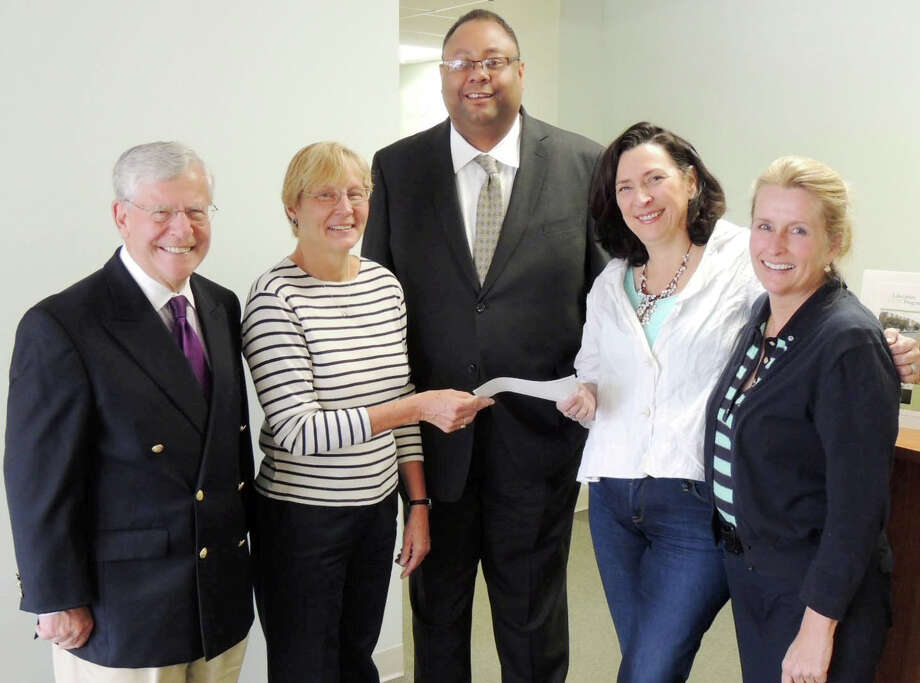 First Church Congregational of Darien donated $12,000 from the proceeds of the annual antiques show to Liberation Programs. From left, John Bassler, Liberation Programs board member; Judith Sinche antique show co-chairman from First Congregational Church of Darien; Alan Mathis, Liberation Programs president and CEO; Debra Hertz, Liberation Programs board chairman; and Molly Watkins, antique show co-chairman. Photo: Contributed Photo, Contributed / Darien News