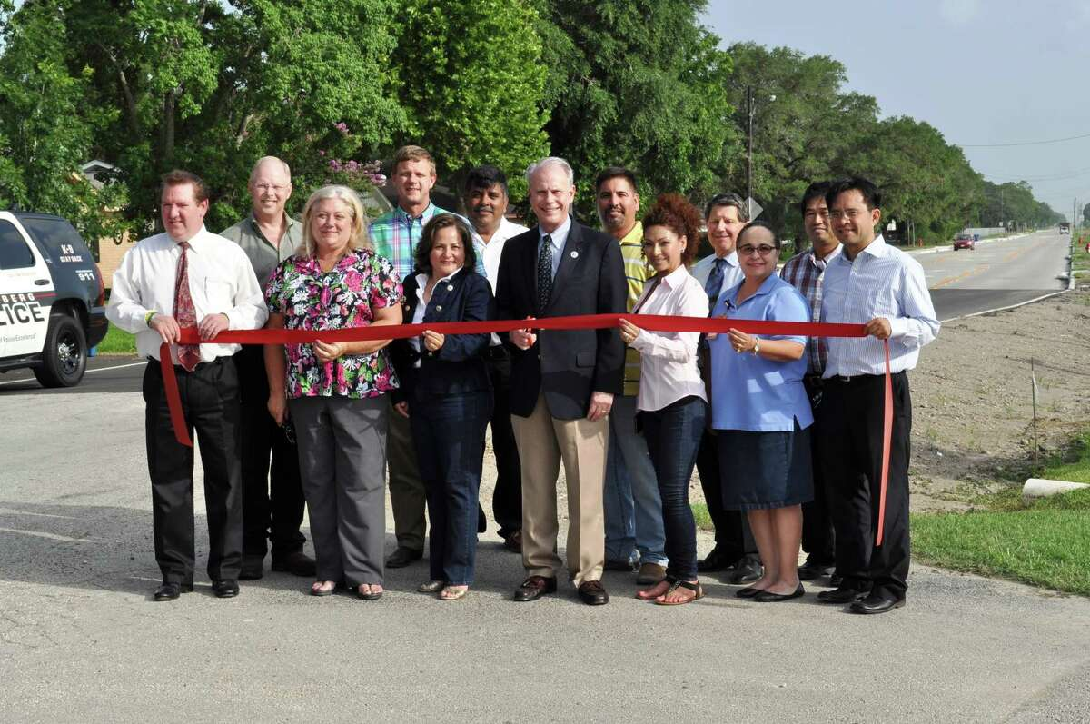 Participating in the official opening of the third phase of Bamore Road were, from left: Councilor William Benton; Councilor Dwayne Grigar; Councilor Amanda Bolf; John Maresh, Assistant City Manager for Public Services; Councilor Cynthia McConathy; Javier Gonzalez, Gonzalez Construction; Mayor Vincent M. Morales, Jr.; Pete Cavazos, Gonzales Construction; Maria Gonzalez, Gonzalez Construction; Larry Janak, IDC; Melissa Peé±a, project director; Steven Yu, IDC; and Hung Nguyen, IDC.