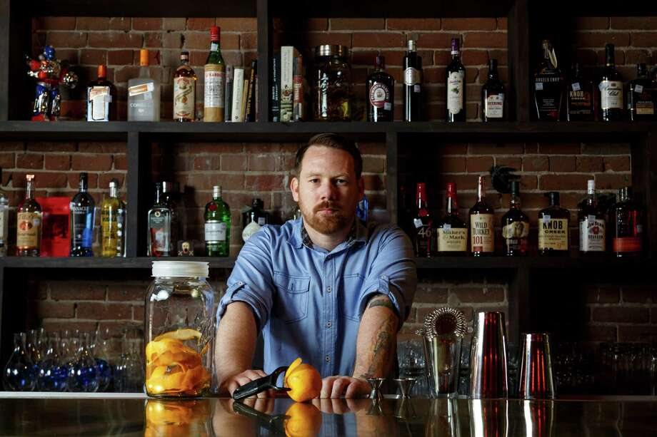 "Bartender Alex Gregg at Goro & Gun, as a Houston job that will always be in demand as long as there are wild nights, first dates, and days that end in ""Y"".  Photo: Michael Paulsen, Staff / © 2013 Houston Chronicle"