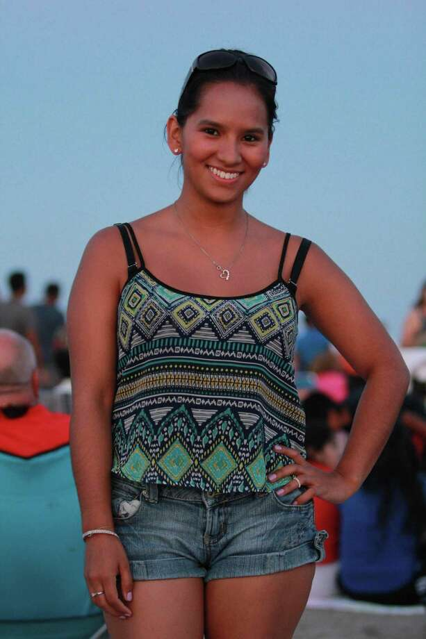 "Sairy Hernandez of Hawthorne, N.J. was among the revelers who gathered at Stamford's Cummings Park for the city's fireworks display on Saturday, July 5. She said of her outfit: ""Fashion style? Hmm, I just love the color blue."" Photo: Derek T.Sterling, Contributed Photo / Stamford Advocate"