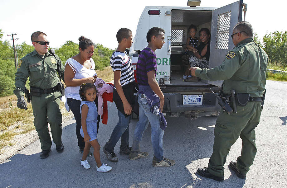 After being questioned, the members of a group of unauthorized immigrants discovered near Anzalduas Park southwest of McAllen are loaded into Border Patrol vehicles. The U.S. now plans to seek more detention facilities for families. Photo: Photos By Jerry Lara / San Antonio Express-News / ©2014 San Antonio Express-News