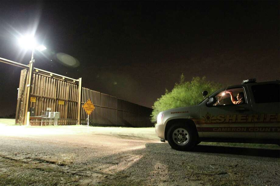 June 26, 2014, 10:05 p.m., Brownsville, Cameron County, Texas - Cameron County Sheriff's Office Sgt. Eric Lopez patrols near George Saenz Lane near a border fence in the county south of Brownsville. With the aid of federal grants, the sheriff's office provides deputies with overtime to patrol the border. Photo: Kin Man Hui, San Antonio Express-News / ©2014 San Antonio Express-News