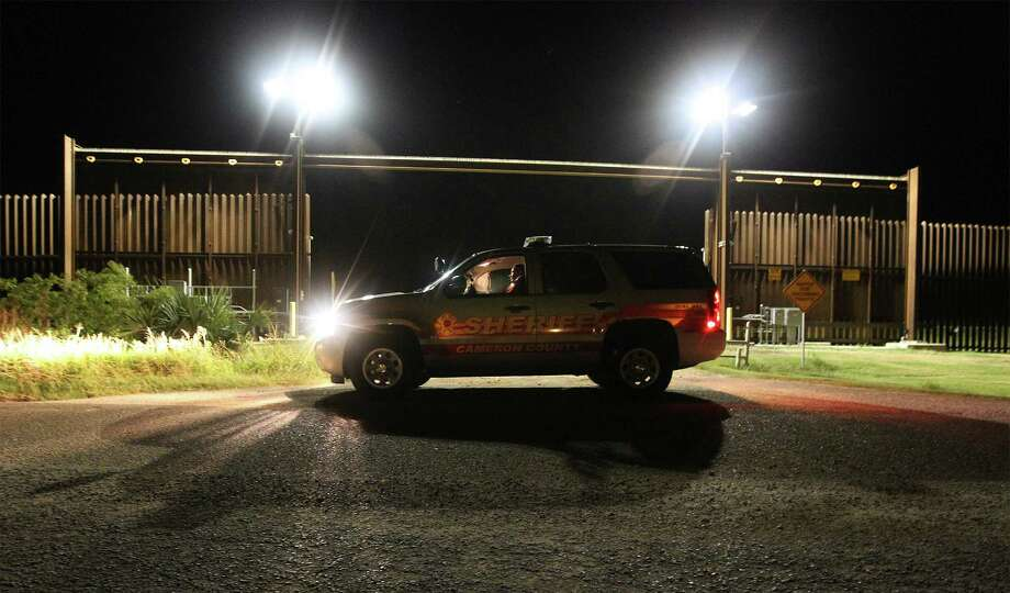 June 26, 2014, 10:13 p.m., Brownsville, Cameron County, Texas - Cameron County Sheriff's Office Sgt. Eric Lopez patrols near FM 1419 or Southmost Blvd. - one of the southern most portions of roadway in the United States that borders Mexico. With the aid of federal grants, the sheriff's office provides deputies with overtime to patrol the border. Photo: Kin Man Hui, San Antonio Express-News / ©2014 San Antonio Express-News