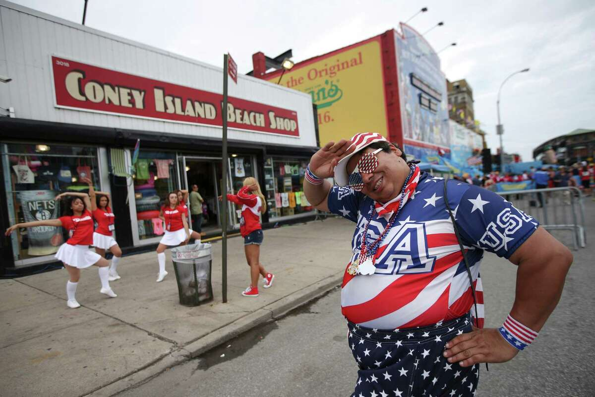 Paul Calienes poses for a photo before the Nathan's Famous Fourth of July International Hot Dog Eating contest at Coney Island, Friday, July 4, 2014, in New York. (AP Photo/John Minchillo) ORG XMIT: NYJM119