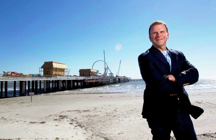 Portrait of entrepreneur, developer and restauranteur Tilman Fertitta next to his latest venture Pleasure Pier along Seawall and 25th St. in Galveston. Photo: Johnny Hanson, Hc / © 2012  Houston Chronicle