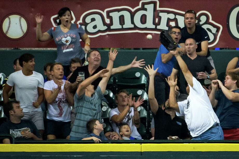 Landry's holds the naming rights to the left field bleachers at Minute Maid Park. A fan who catches a home run can receive a gift certificate to one of the company's restaurants. Photo: Smiley N. Pool, Hc / © 2013  Smiley N. Pool