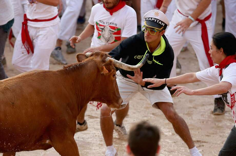 If you wear a yachting capwhile running with the bulls of Pamplona, you're just asking to be   gored. Photo: Christopher Furlong, Getty Images