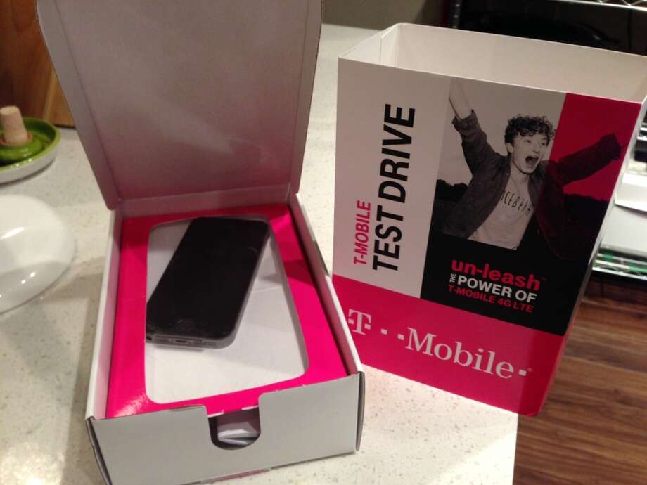 My T-Mobile Test Drive iPhone 5S - a 64-GB model - came in very un-Apple-like packaging. I suspected it might be a refurbished unit, but a T-Mobile spokesperson didn't respond when I asked. Photo: Dwight Silverman, Houston Chronicle