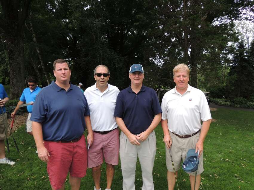 Golfers tee off to help homeless veterans at the 10th Annual Homes for the Brave Golf Classic at the Connecticut Golf Club in Easton on June 30.