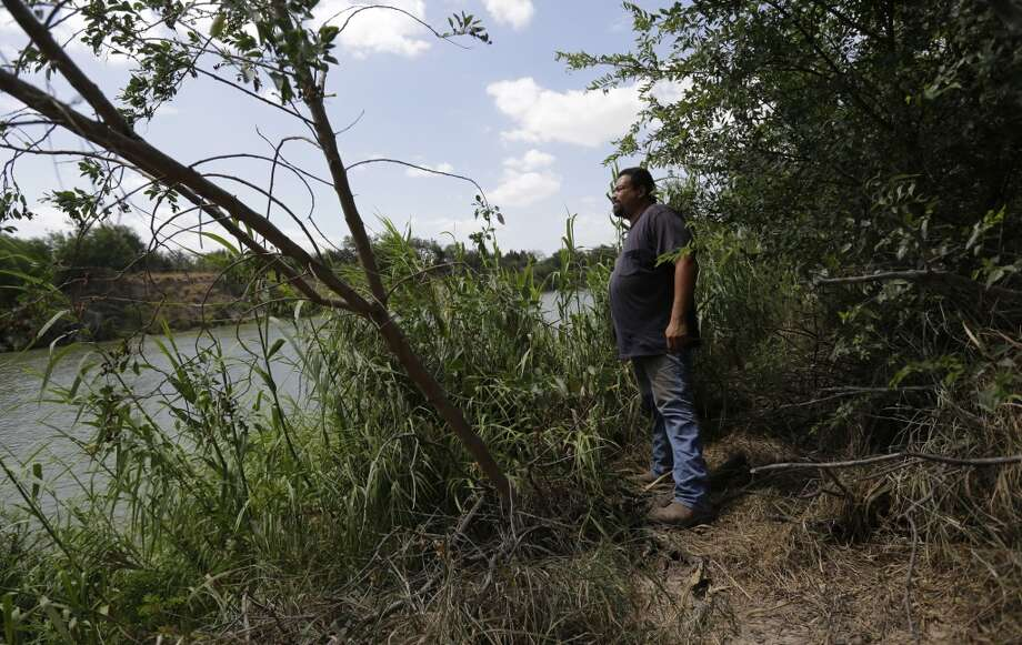 In this June 20, 2014 photo, Napoleon Garza stands on his property along the Rio Grande at a site where immigrants cross the U.S.-Mexico border illegally in Granjeno, Texas. Just since October, the Border Patrol's Rio Grande Valley sector has made more than 194,000 arrests, nearly triple that of any other sector. Most are from Central America, and many are children. Photo: Eric Gay, Associated Press