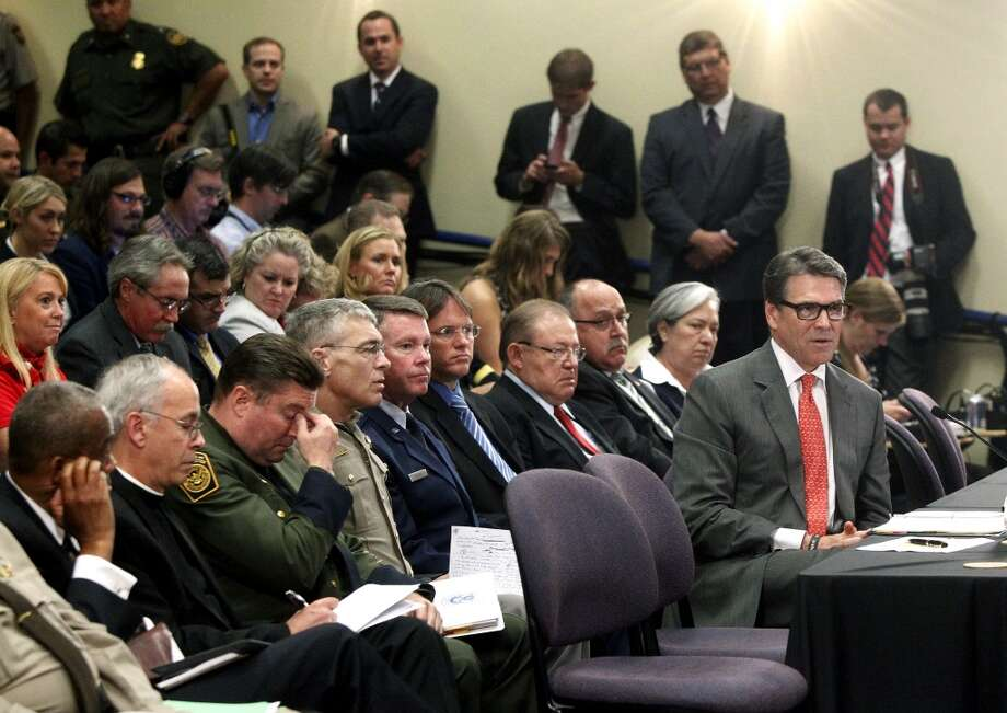 Texas Gov. Rick Perry talks to members of the U.S. House Committee on Homeland Security about the humanitarian and national security crises going on along the Texas-Mexico border Thursday July 3, 2014 in McAllen, Texas.  Perry said that the tens of thousands of Central American children entering the U.S. illegally is both a humanitarian crisis and a national security one. Photo: Gabe Hernandez, Associated Press