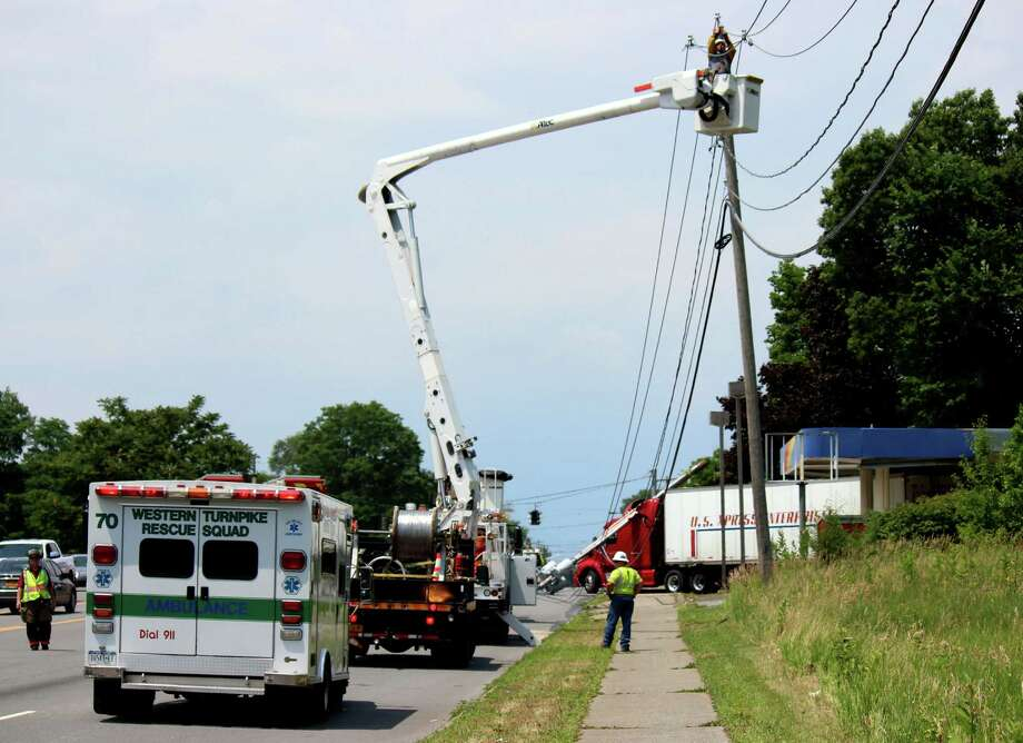Utility lines on Route 20 near the entrance to Crossgates Mall were knocked down by a tractor-trailer Monday afternoon, July 7, 2014, in Guilderland N.Y. (Selby Smith / Special to the Times Union)